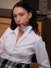 Brunette girl is cleave gagged and rope bound in her school uniform