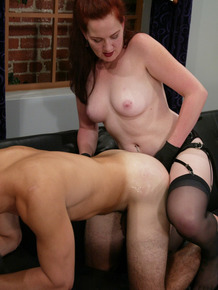 Redhead female pegs her male submissive after bending him over on couch