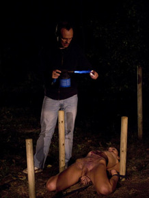 Slim teen gets covered in wax during a BDSM session with her handler