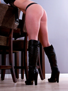 Solo model Meet Madden tales off her dress to pose in boots and underthings