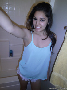 Petite amateur brunette cutie Selena takes a selfie of her hot tits and ass