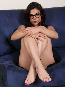 Nerdy girl removes her ballet flats and nylons to display pretty feet