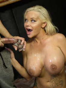Hot blonde with big boobs gets on her knees for an interracial blowbang