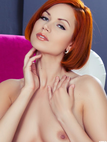 Provocative redhead Kami flaunts her natural tits and gorgeous butt