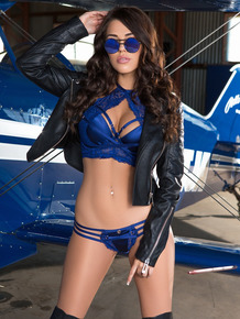 Astoundingly sexy Australian pilot Marlee May poses in lingerie on her plane