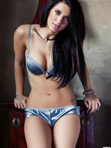 Adorable brunette with amazing body getting rid of her lingerie