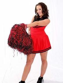 Brunette cheerleader Kelly Divine flaunts her juicy in the nude