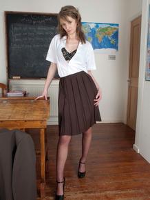Schoolteacher strips down her nylons and heels on her classroom desk