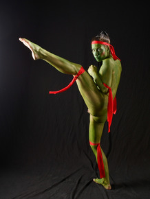 Hot cosplay chick Shana Lane stretches & squats nude revealing her green pussy