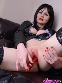 British slut Tina Kay pleases herself in spectacular costume on the sofa