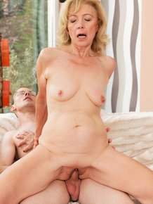 Old blonde woman sports a creampie after her toy boy bangs her