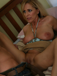 Big tit milf Nicole gets pussy licked on the bed and fucked as well