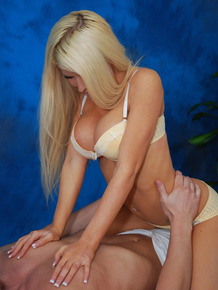 Hot 18 year old blonde masseuse gets on top a client during a massage