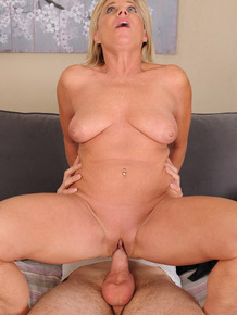 Slutty mature woman Payton Hall makes a stud's cock rock hard before riding it