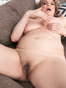 Old woman Crystal King fucked by younger man at her first XXX photo session
