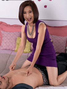 Hot mature Asian woman Kim Anh gets a big tit massage from her young stud