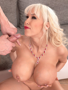 Sexy MILF Sandra Star uncovers massive big tits to seduce the office IT guy