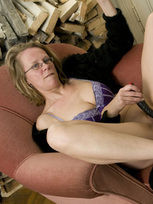 Mature granny Marga still feels the need to toy her horny old pussy