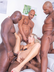 Blonde female Ria Sunn gets double fucked during an interracial gangbang