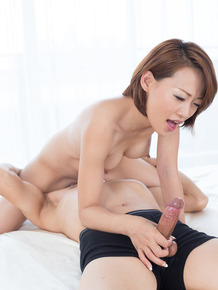 Naked Japanese girl coaxes jizz from a cock with a handjob