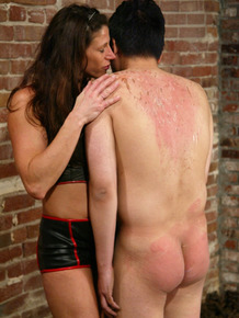 Impudent dominatrix Kym Wilde punishes obedient buddy with wax and spanking