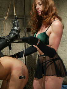 Dominatrix Kym Wilde extracts pleasure via pain from a male sub