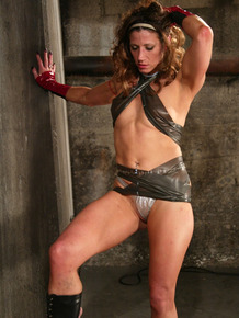 Brutal dominatrix Kym Wilde in boots steps on bound slave's face for worship