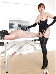 Mature femdom in high-heeled boots pleasing her masked male pet's hard cock