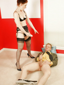 Horny mature femdom torturing a guy's balls and taking off her dress