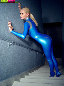 Hot blonde unzips blue cat suit at the crotch to expose her snatch