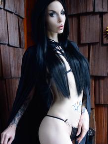 Goth girl Razor Candi flaunts her big ass over a pumpkin in Halloween attire