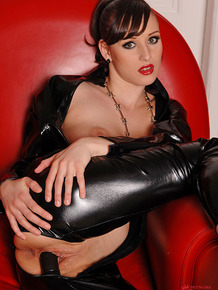 Dazzling fetish girl Leo in hot latex toying her pussy with legs spread wide