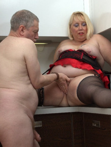 Fat blonde has her pussy licked and and fingered in lingerie and nylons