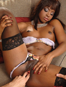 Hot black girl open overcoat to seduce her man in lingerie and hosiery