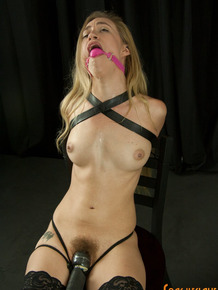 Skinny blonde Lyra Law dons a ball gag while being fucked by a sex machine