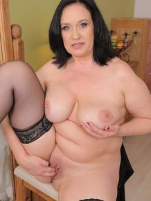 Older BBW Ria Black works a huge black dildo up her shaved vagina