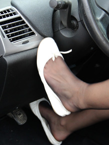 Hot driver removes her shoes waiting and airs her hot toes in pantyhose