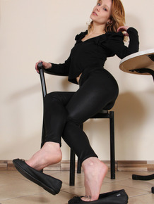 Natural redhead Stella releases tattooed feet from ballet flats while dressed