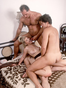 Blonde tramp Edith gets spit roasted and DP in vintage orgy party