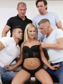 Tall blond girl Cherry Kiss gets double fucked during the course of a gangbang