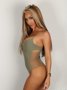 Blonde bombshell shows her incredible body & tits in sexy one piece swim suit