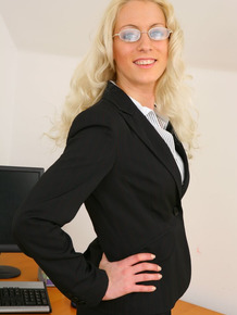 Leggy secretary Shelley R strips to her garters and nylons at her desk