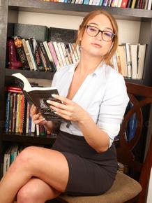 Nerdy woman Skylar Snow rides a suction dildo on hardwood floor in her study