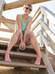 Cute redhead Angelina undresses for her first nudes up on a fire lookout spot