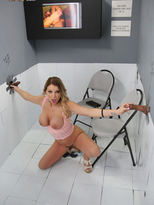 Blonde slut sucks off two black cocks at a gloryhole without a second thought