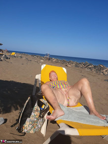 Old SSBBW Val Gasmic dyes her hair red before exposing herself on the beach