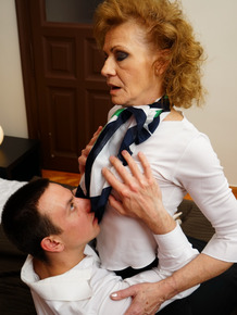 Old housewife with curly hair and her toy boy kiss before having sex
