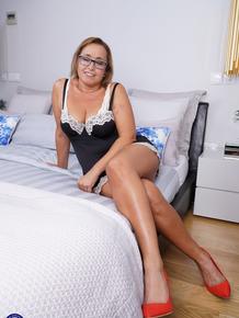 Spanish housewife Conchita gets completely naked before she masturbates