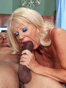 Hot older woman Mandi McGraw gets ass fucked by a black gentleman