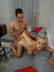 Grey haired granny and her young boy toy get down to fucking after foreplay